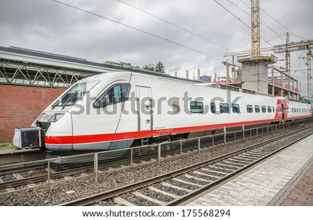 TIKKURILA, FINLAND -27 JUNE: Modern passangers train at Tikkurila station on 27, June 2013. Passenger trains are operated by the VR Group. They serve the major cities and rural areas in Finland. - stock photo