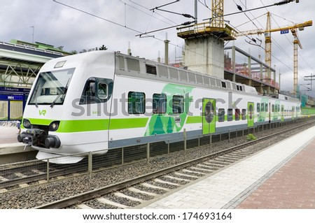 TIKKURILA, FINLAND -27 JUNE: Modern passangers train at Tikkurila station on 27, June 2013. This train is operated by the private state-owned VR Group. They serve all the major cities and rural areas. - stock photo