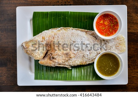 Tilapia grilled with 2 spicy sauce  on banana leaf - stock photo