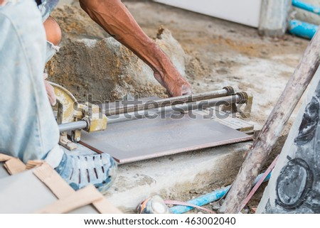 Tile cutting worker working with floor tile cutting
