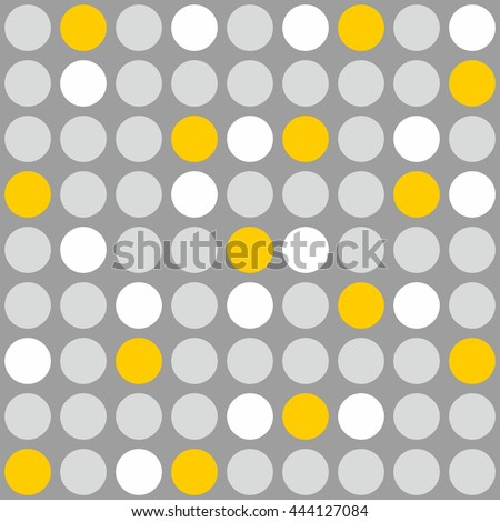 Tile pattern with grey, white and yellow polka dots on grey background