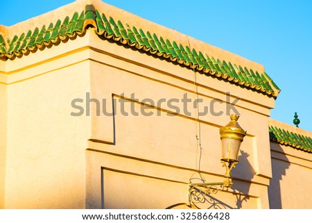 tile roof  moroccan old wall and brick in antique city - stock photo