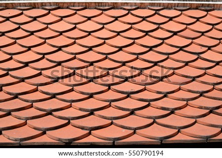 Tile roof of old Thai temple texture background surface natural color