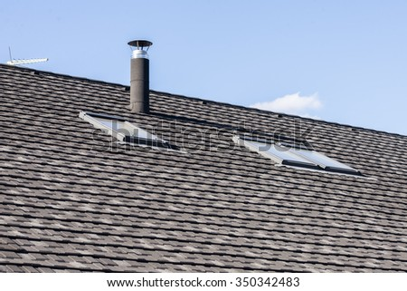 tile roof with windows and chimney