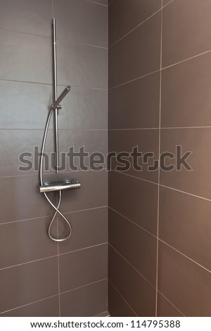 Tiled bathroom shower with stone tiles. Home interiors. - stock photo
