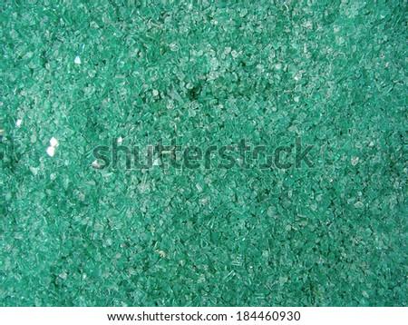Tiled floor with broken glass. - stock photo