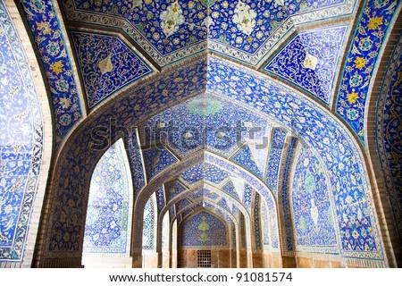 Tiled oriental arcs and pillars on Jame Abbasi mosque, Esfahan, Iran - stock photo