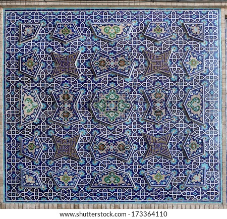 Tiled oriental ornaments Jame mosque's wall , Esfahan, Iran - stock photo