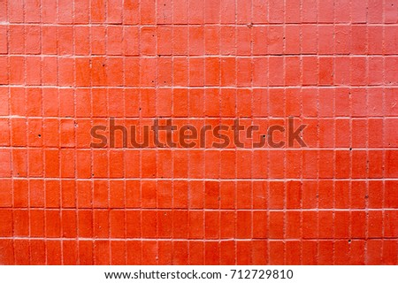 Tiled red wall, background
