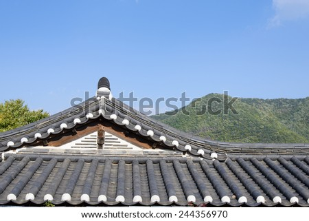 tiled roof of Korean traditional Architecture with clear sky - stock photo