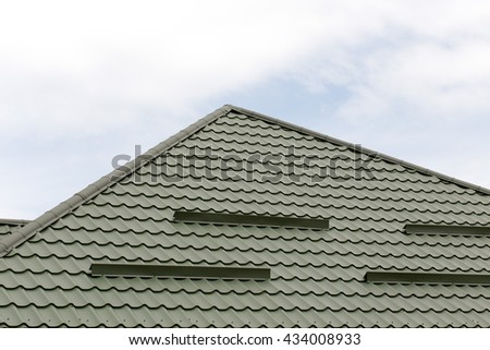 tiled roof on a new home with blue sky