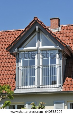 Tiled Roof With New Or Renovated Dormer Window