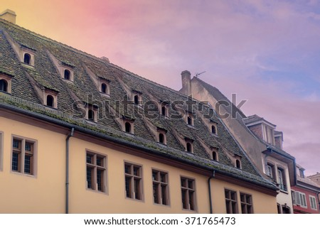 Tiled roofs of old buildings in a famous French city Strasburg