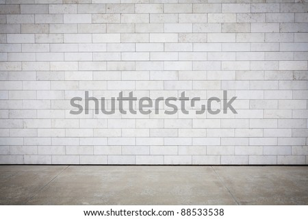Tiled wall with a blank white bricks - stock photo