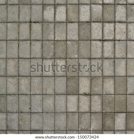 Tiled with paving stone bricks path's fragment as an abstract background - stock photo