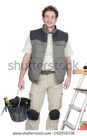 Tiler preparing to start project - stock photo