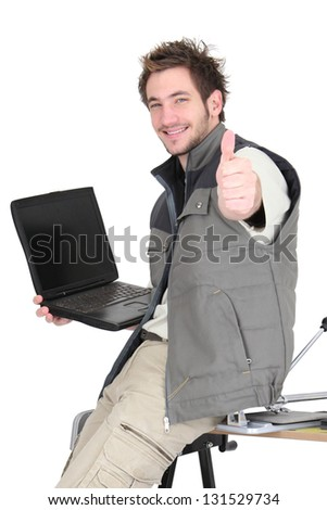 Tiler with a laptop - stock photo