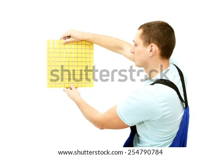 Tiler with mosaic tile in hands isolated on white - stock photo
