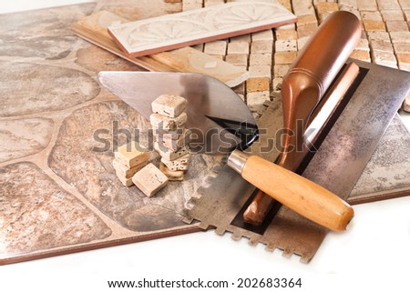 Tiles for interior and exterior use, trowel, spatula - stock photo