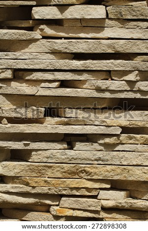 Tiles from sandstone close up. Vertical background  - stock photo