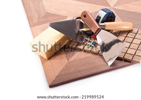 Tiles, trowel .meter, trowel and sponge, crosses on a white background - stock photo