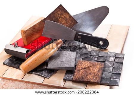 Tiles, trowel, spatula, decorative elements on a white background - stock photo