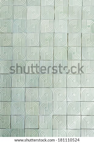 Tiles with circles and lines on building wall - stock photo
