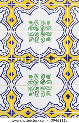Tiles with colorful floral motifs and yellow background