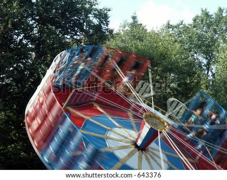 tilt-a-whirl in an amusement park - stock photo