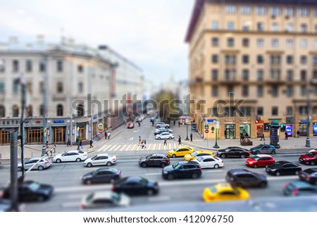 Tilt shift blur effect. Car and pedestrian traffic, Moscow, Russia, 25 April, 2016  - stock photo