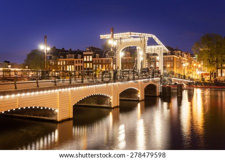 tilt shift image of skinny bridge in Amsterdam, the Netherlands, miniature night scene