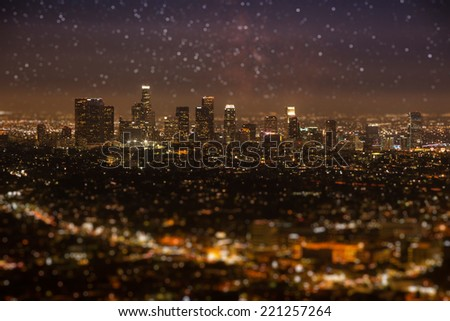 Tilt-shift of Downtown Los angeles cityscape in early night with glowing stars on the sky. - stock photo
