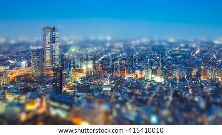 Tilt shift Photo High-rising buildings lighting up in tokyo - stock photo