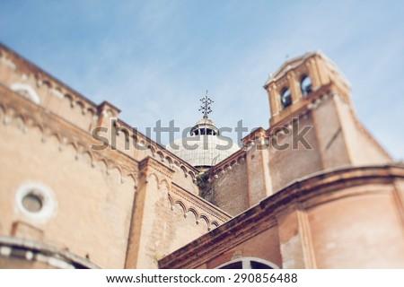 Tilt shift photo of basilica Santi Giovanni e Paolo in Venice. Soft focus - stock photo