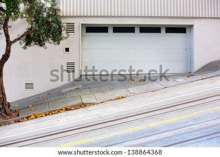 tilted street with garage and tree