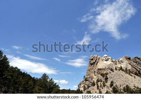 Tilted view of Mount Rushmore National Memorial in South Dakota, featuring sculptures of former U.S. presidents George Washington, Thomas Jefferson, Theodore Roosevelt and Abraham Lincoln. - stock photo