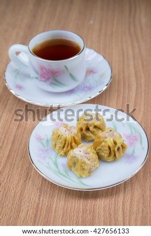 Tim sum or Dim sum.(Steamed pork dumpling) a very good taste and famous Chinese Food. Selective Focus