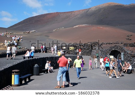 TIMANFAYA, LANZAROTE - 29 OCTOBER: Tourists in Timanfaya National Park in Lanzarote on October 29, 2009 - stock photo