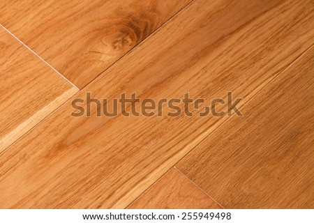 Timber floor background. The structure of wood covered with a protective varnish. Sample of a wooden floor covering
