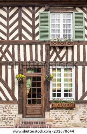 timber frame building in Beuvron en Auge, Nomandy, France - stock photo