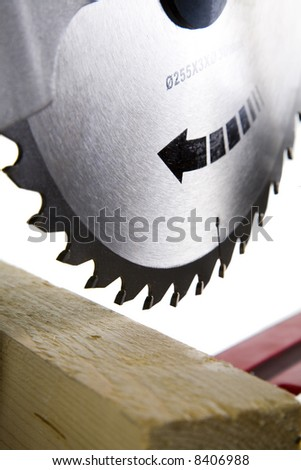 Timber Ready to bo Cut with Mitre Saw, Blade in Focus - stock photo