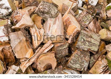 Timber wood in chaos like a background or texture with details - stock photo