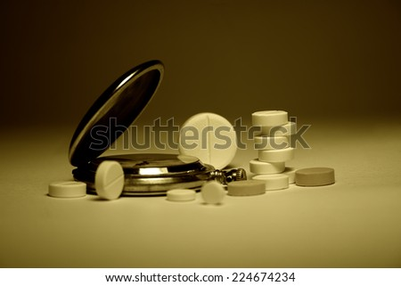 Time and medication - stock photo