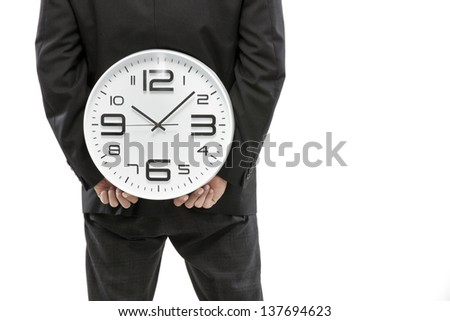 Time concept,Businessman hiding big clock behind him