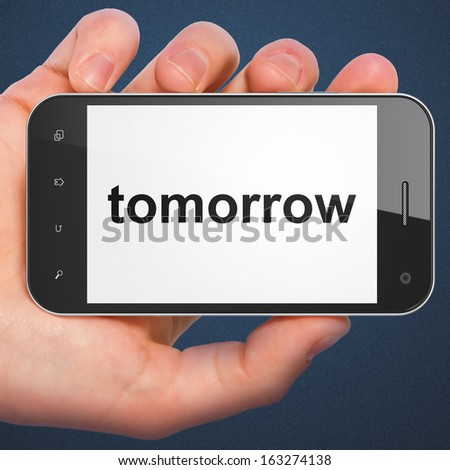 Time concept: hand holding smartphone with word Tomorrow on display. Mobile smart phone on Blue background, 3d render - stock photo