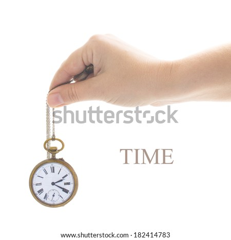 time concept - someones hand holding antique old  clock isolated on white background
