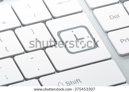 Time concept: Watch on computer keyboard background