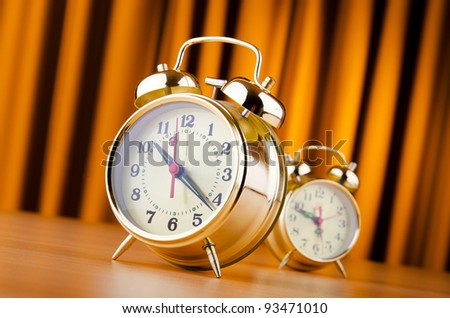 Time concept with alarm clock