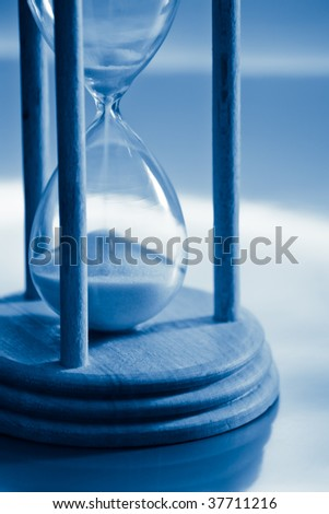 time concept with hourglass blue toned