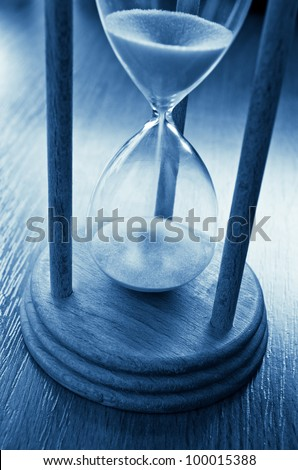 time concept with hourglass blue toned image - stock photo